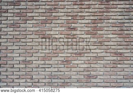 The Wall Is Made Of Ceramic Clinker Bricks. Natural Urban Background. Space For Creativity And Text.