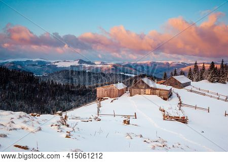 Snow-capped mountain huts in the frosty day. Location place Carpathian mountains, Ukraine, Europe. Vibrant photo wallpaper. Happy New Year! Discover the beauty of earth.