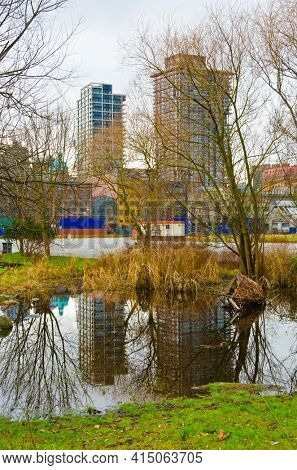 A view at Downtown and it's reflection in water of padle in Vancouver, Canada from Portside Park.