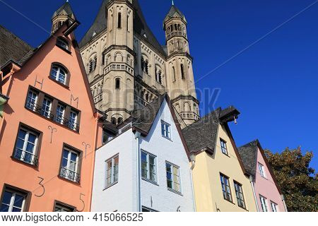 Cologne Old Town, Germany. Colorful Architecture Of Fish Market (fischmarkt) And Great Saint Martin