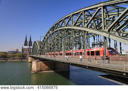 Cologne, Germany - September 22, 2020: People Visit Hohenzollern Bridge (hohenzollernbrucke) In Colo