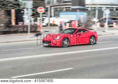 Moscow, Russia - March 2021: Side View Of Red Ferrari California In The City Street. Rental Supercar
