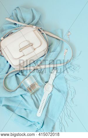 Woman Fashion Trendy Stylish Pastel Blue Accessories Set On Blue Background. Flat Lay, Top View.