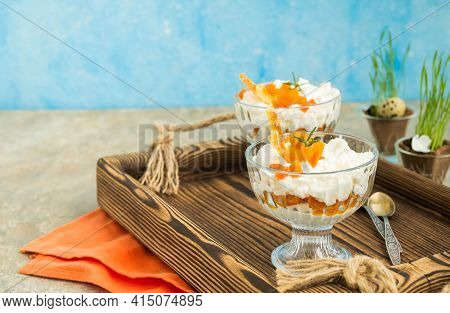 Finnish Cottage Cheese Easter Dessert With Whipped Cream And Dried Apricots In Glass Bowls On A Ligh
