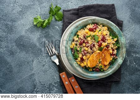 Mexican Black Bean Corn Quinoa Salad With Caramelized Lemon In Old Vintage Clay Bowl On A Dark Gray