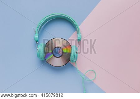 Cd With Headphones. High Quality And Resolution Beautiful Photo Concept