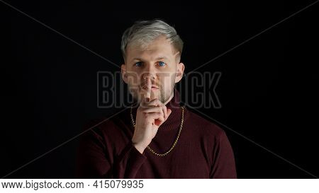 Strict Serious Man Asking To Stay Calm, Keep Silence Or Secrecy With Finger On Lips Gesture, Mysteri