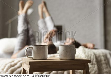 Coffee Cups Table With Couple Bed. High Quality And Resolution Beautiful Photo Concept