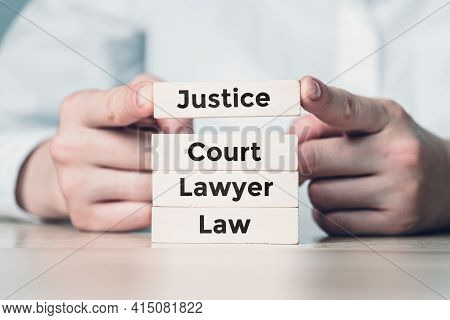The Concept Of The Work Of The Judicial System On Wooden Blocks Built By A Person.