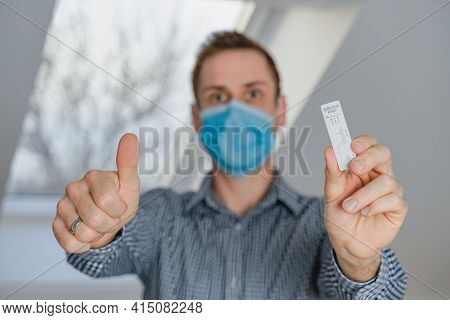 Thumbs Up For Corona Virus Rapid Test - Worldwide Corona Virus Pandemic Concept - Young Man Has Test