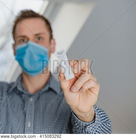Man Does Rapid Self Test For Covid-19 Home Test Kit. Coronavirus Nasal Swab Test For Infection, Pcr