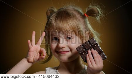 Close-up Portrait Of Teen Child Kid With Milk Chocolate Bar Showing Thumb Up Gesture, Ok Sign. Addic