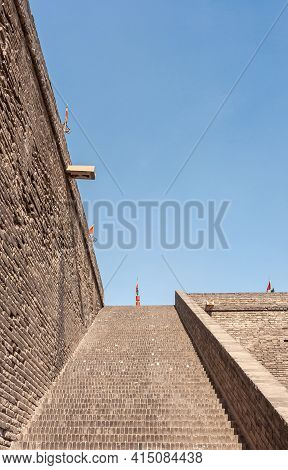 Xian, China - April 30, 2010: Huancheng City Wall. Brown Brick Long Stairway Up To Top Of Rampart Un