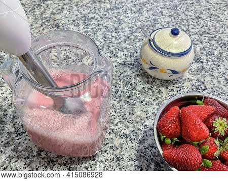 Bowl Full Of Strawberries And A Pitcher With Freshly Made Strawberry Milkshake, A Sugar Bowl With A