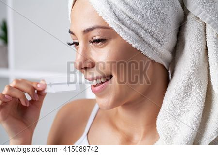Teeth Whitening, Beautiful Smiling Woman Holding A Whitening Strip.