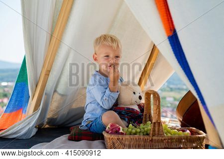 Happy Childhood. Child In Tent. Boy Playing Outdoor. Kids Camping. Having Fun Outdoors. Campground