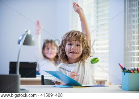 Schoolboy Answering. Lesson In Classroom. Education And Learning. Schoolboy And Schoolgirl