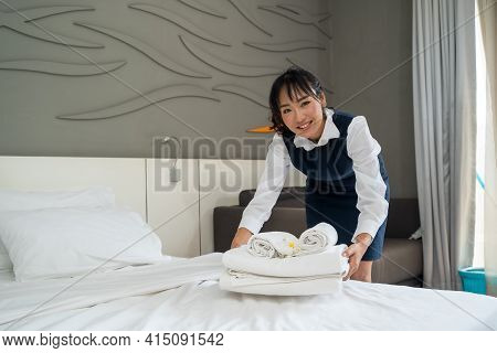 Room Service Maid Cleaning Room In The Hotel,professional Maid Changing Bedclothes In A Room Hotel.
