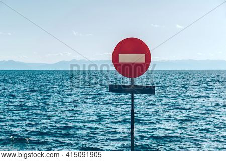The Movement Of Vehicles Is Prohibited. Road Sign On The Background Of The Sky And The Ocean. Prohib