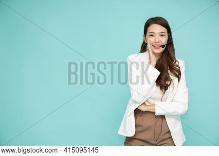 Portrait Of Happy Smiling Asian Woman Customer Support Phone Operator Isolated On Green Background,