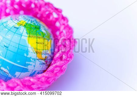 Globe Ball Was Covered With A Foam Net Wrapped In Fruit. Concept Of Environmental Pollution Concerni