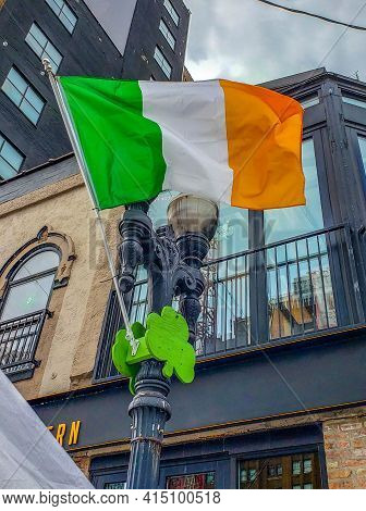 Republic Of Ireland National Flag Flying In The Breeze From A Flagpole Adorned With A Green Shamrock