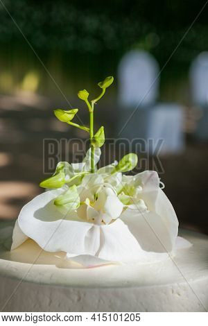 Wedding Cake With Flowers On Top At Thailand