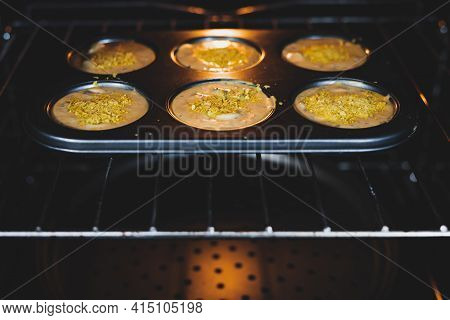 Vegan Savoury Muffins With Olives And Nutritional Yeast In The Oven, Healthy Plant-based Food