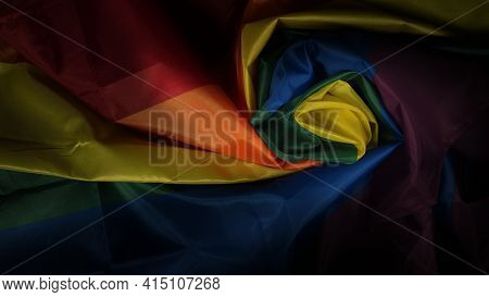 Lgbtq Flag And Hand Black Background
