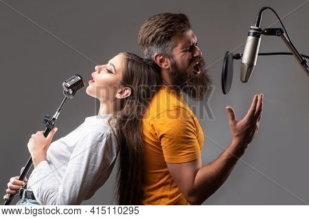 Couple Singing. Friends With Microphone Singing Song. Musician In Music Hall