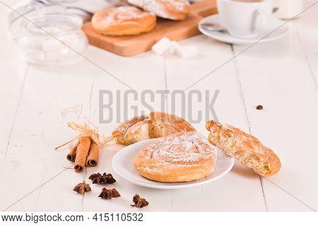 Sweet Pastry Swirls With Cinnamon On White Dish.