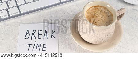 Banner With Break Time. Concept Time Off. Words Break Time In Note On The Working Table With Cup Of