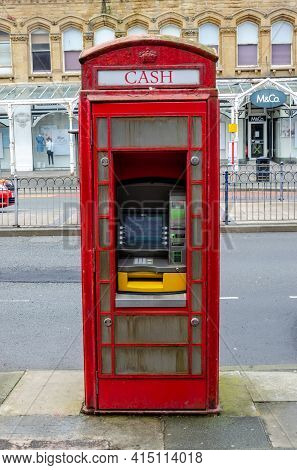 Llandudno, Uk: Mar 18, 2021: A Telephone Box On Gloddaeth Street Has Been Converted So That It Can A