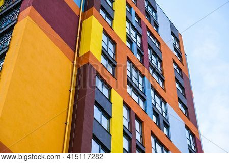 Modern Building Angle And Windows. Multistory New Multicolored Apartment Building. Stylish Living Bl