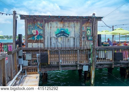Key West, Usa - 04.30.2017: Sunset Pier, Wooden Pier And Bar By The Sea With Posters, Graffiti And P