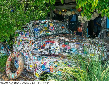 Key West, Usa - 04.30.2017: A Very Old Pickup Truck With A Lot Of Stickers On It Parked On A Wooden