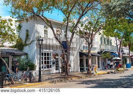 Key West, Usa - 04.30.2017: Duval Street In Wooden District On A Sunny Day With Trees, Colorful Wood