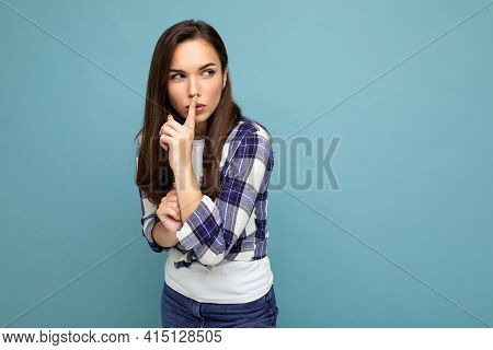 Young Serious Angry Beautiful Brunet Woman With Sincere Emotions Wearing Trendy Check Shirt Standing