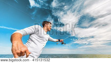 Fishing man casting line recreational activity during summer. Fisherman outdoor on blue sky banner crop background. Sport fishing fish.