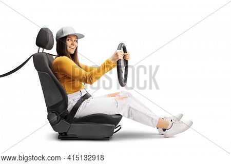 Young female driving with a seatbelt isolated on white background
