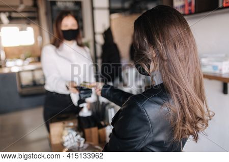Female Customer Making Wireless Or Contactless Payment Using Credit Card. Customer In Focus. Store W