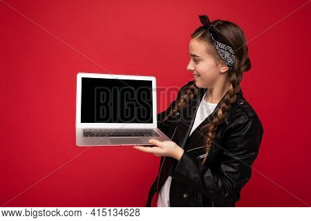 Photo Of Beautiful Happy Smiling Girl With Brunet Pigtails Holding Netbook Wearing Black Jacket And