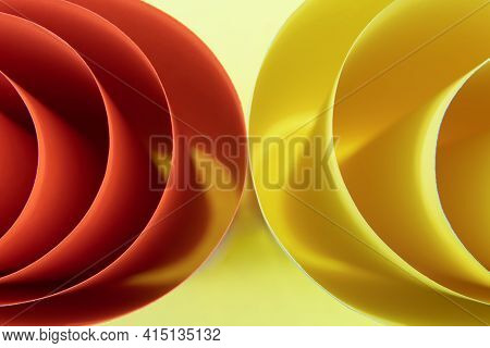 Abstract Colored Macro Background, Created With Curved Yellow And Orange Paper Sheets. Curved Lines