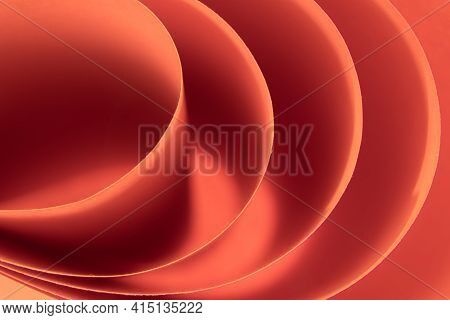 Abstract Colored Macro Background, Created With Curved Red Paper Sheets. Curved Lines And Shapes And