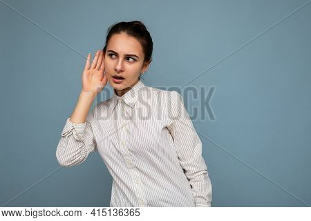 Portrait Of Young Beautiful Brunette Woman With Sincere Emotions Wearing White Shirt Isolated Over B