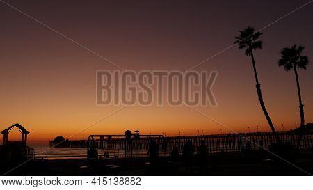 Oceanside, California Usa - 8 Feb 2020: Silhouette Of Waterfront Playground Near Pier. Children Play