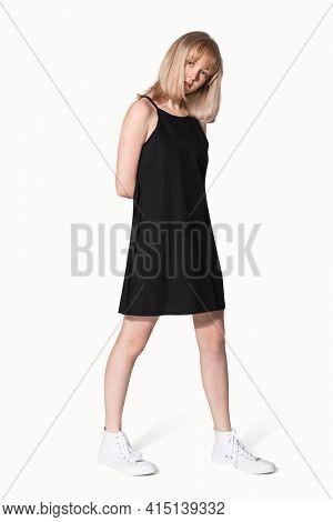Blonde girl in black a-line dress for teen's summer apparel shoot