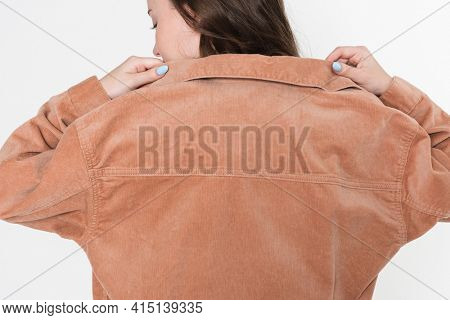 Brown denim jacket for winter apparel shoot with design space rear view