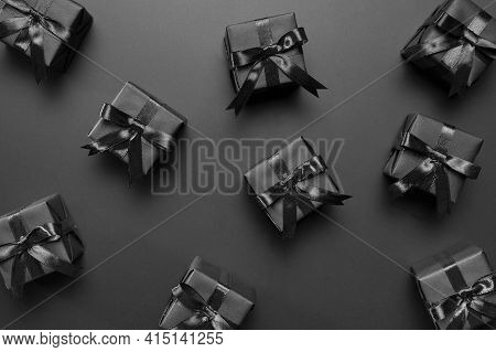 Black Gifts Arrangement Black Background. High Quality And Resolution Beautiful Photo Concept
