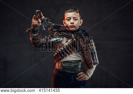 Youth Survivor With Gun In Rags Pose In Dark Background